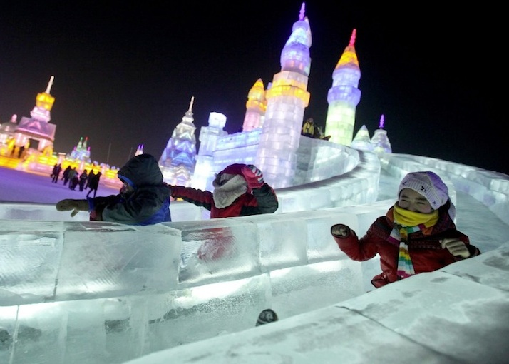 Children enjoying the slides at the Harbin Ice Festival in China. Photo from www.mymodernmet.com